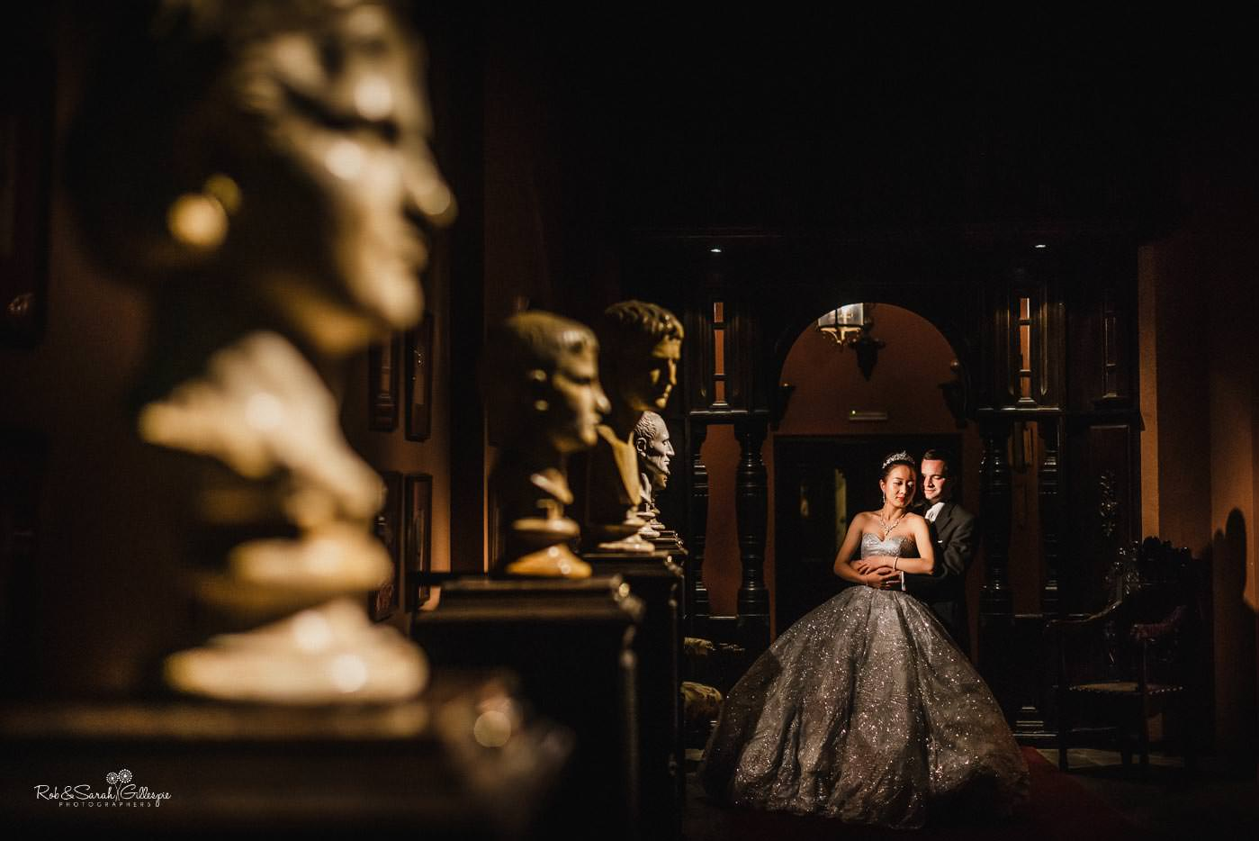 Beautiful wedding photo with bride and groom inside Coombe Abbey