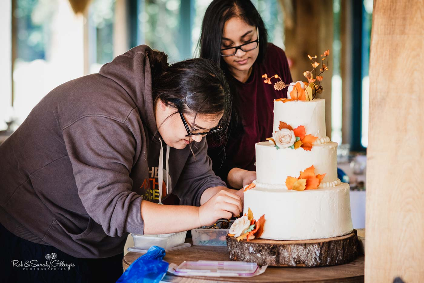 Guests complete wedding cake at Hazel Gap Barn