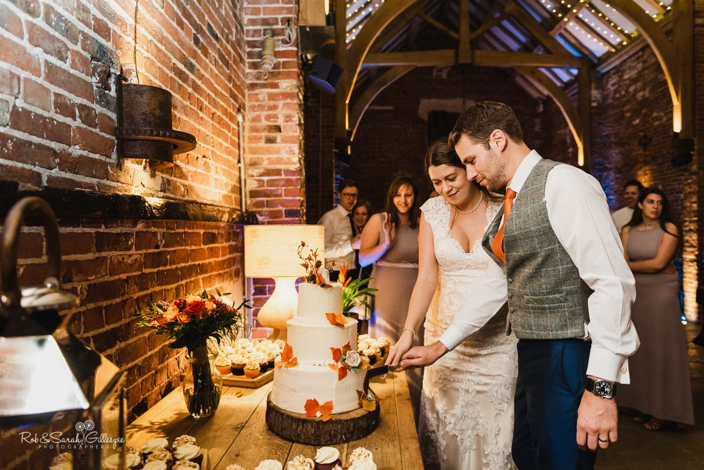 Bride & groom cut wedding cake at Hazel Gap Barn