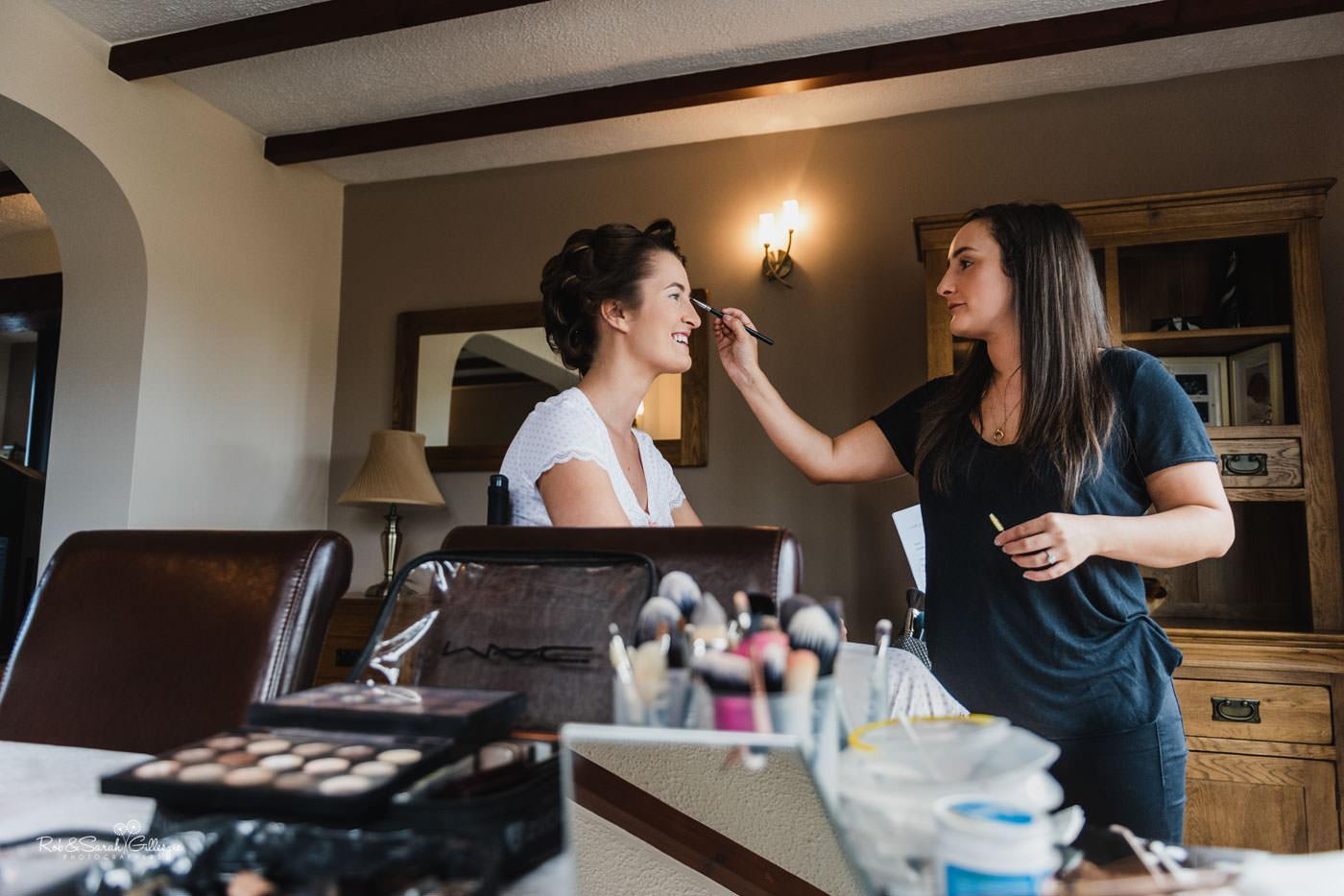 Bride having makeup applied by Chloe McCall MUA