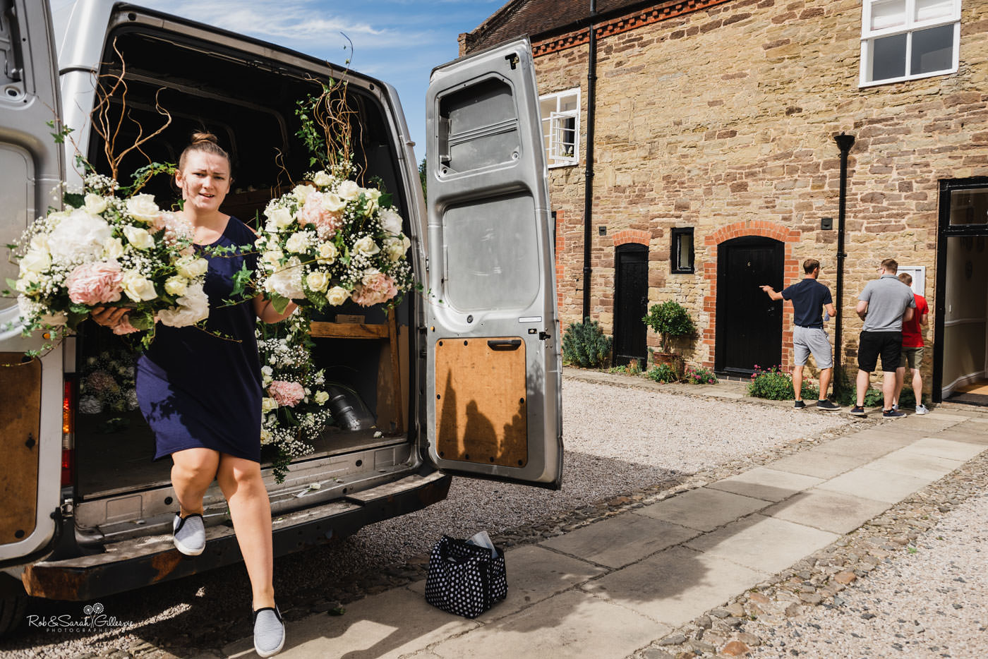 Florist unloads flowers for wedding at Delbury Hall