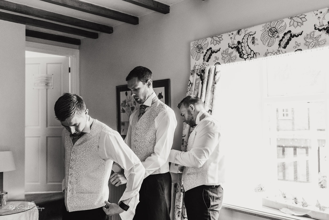 Groom and friends prepare for wedding at Delbury Hall in Shropshire