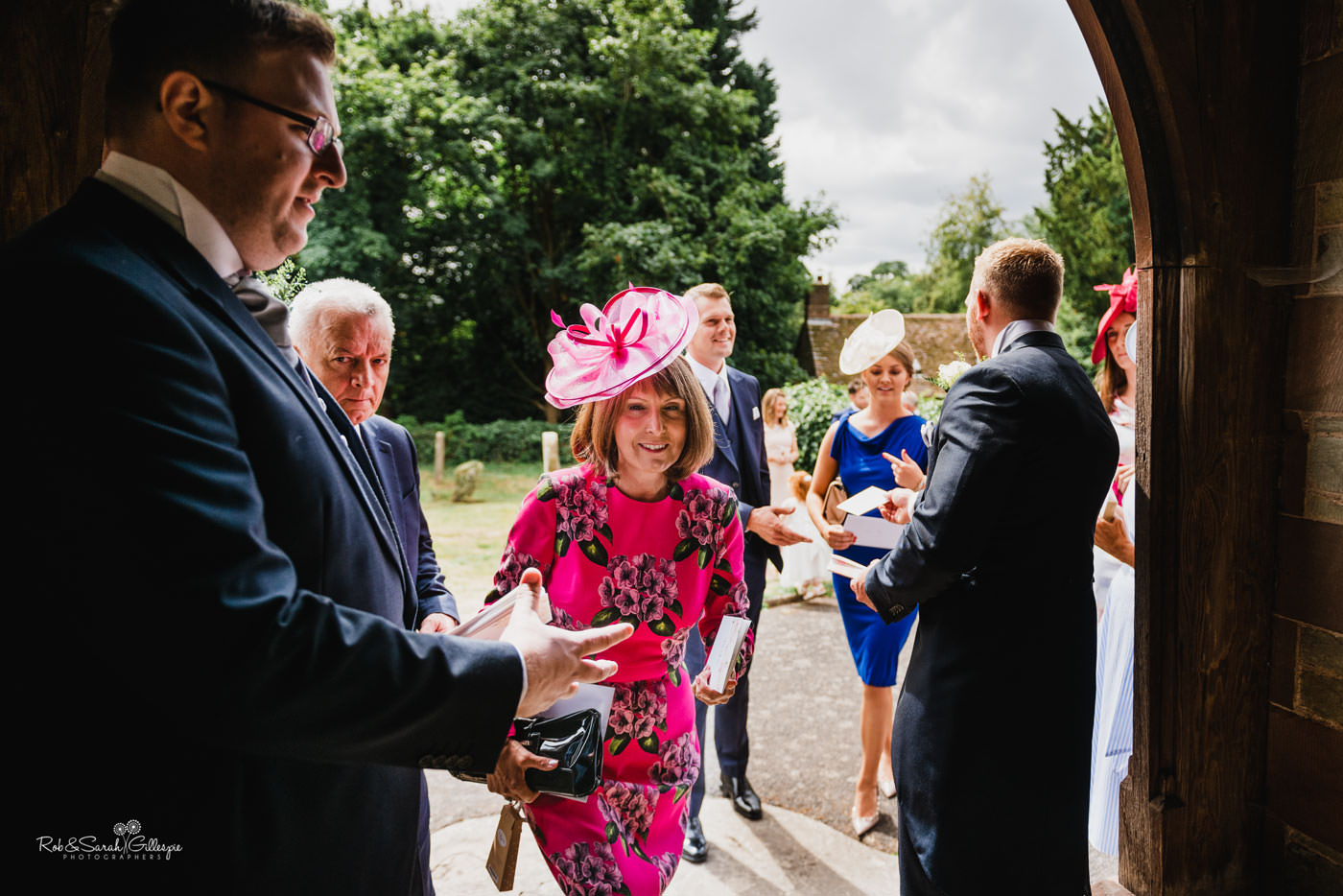 Wedding guests arrive at St Peter's Church Diddlebury