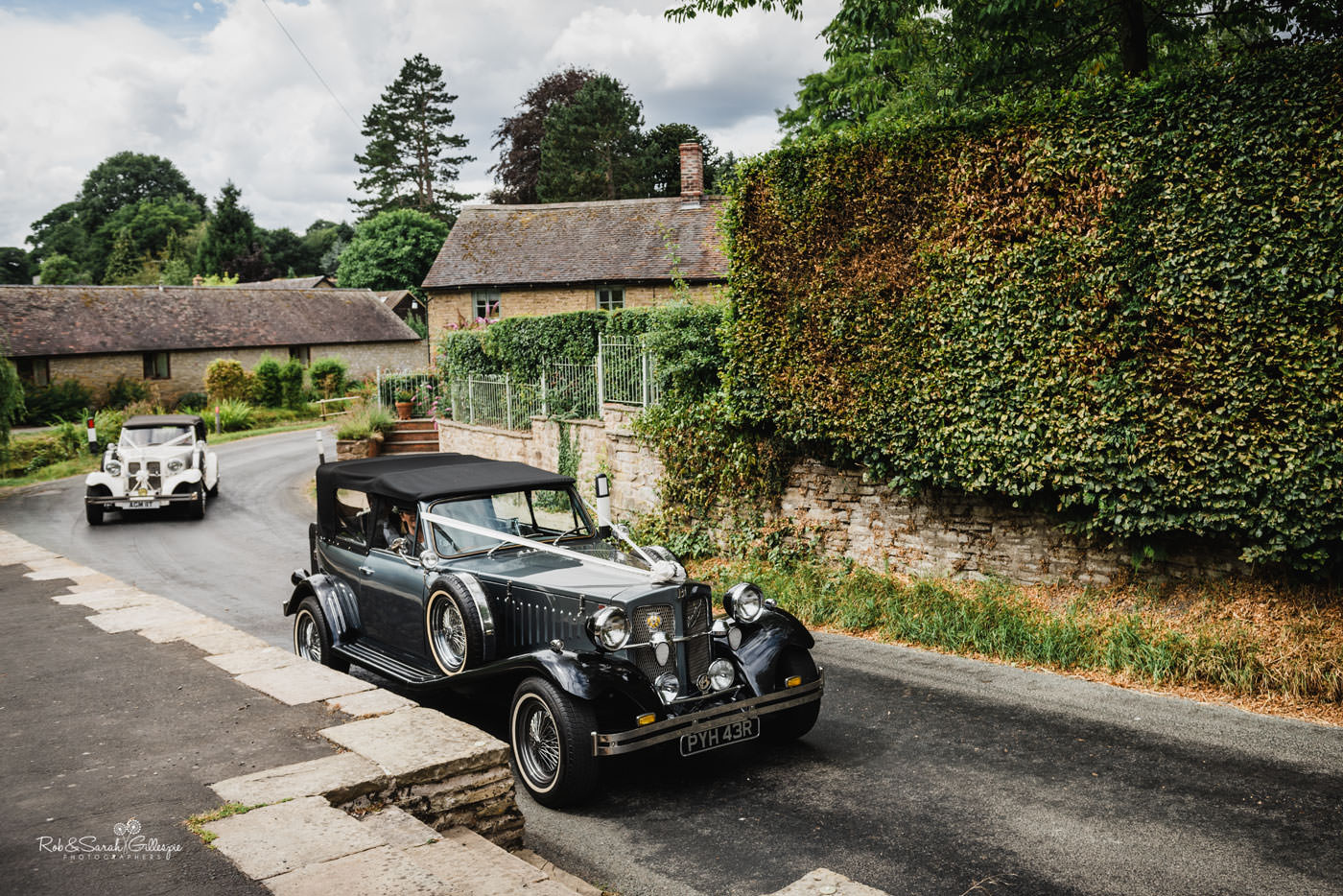 Wedding cars arrive at St Peter's Church in Diddlebury Shropshire