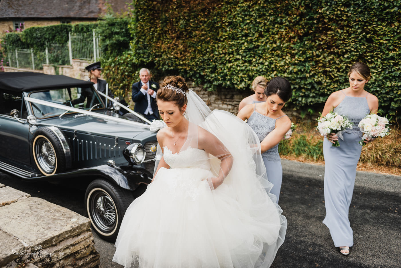 Bride in wedding car arrives at St Peter's Church Diddlebury