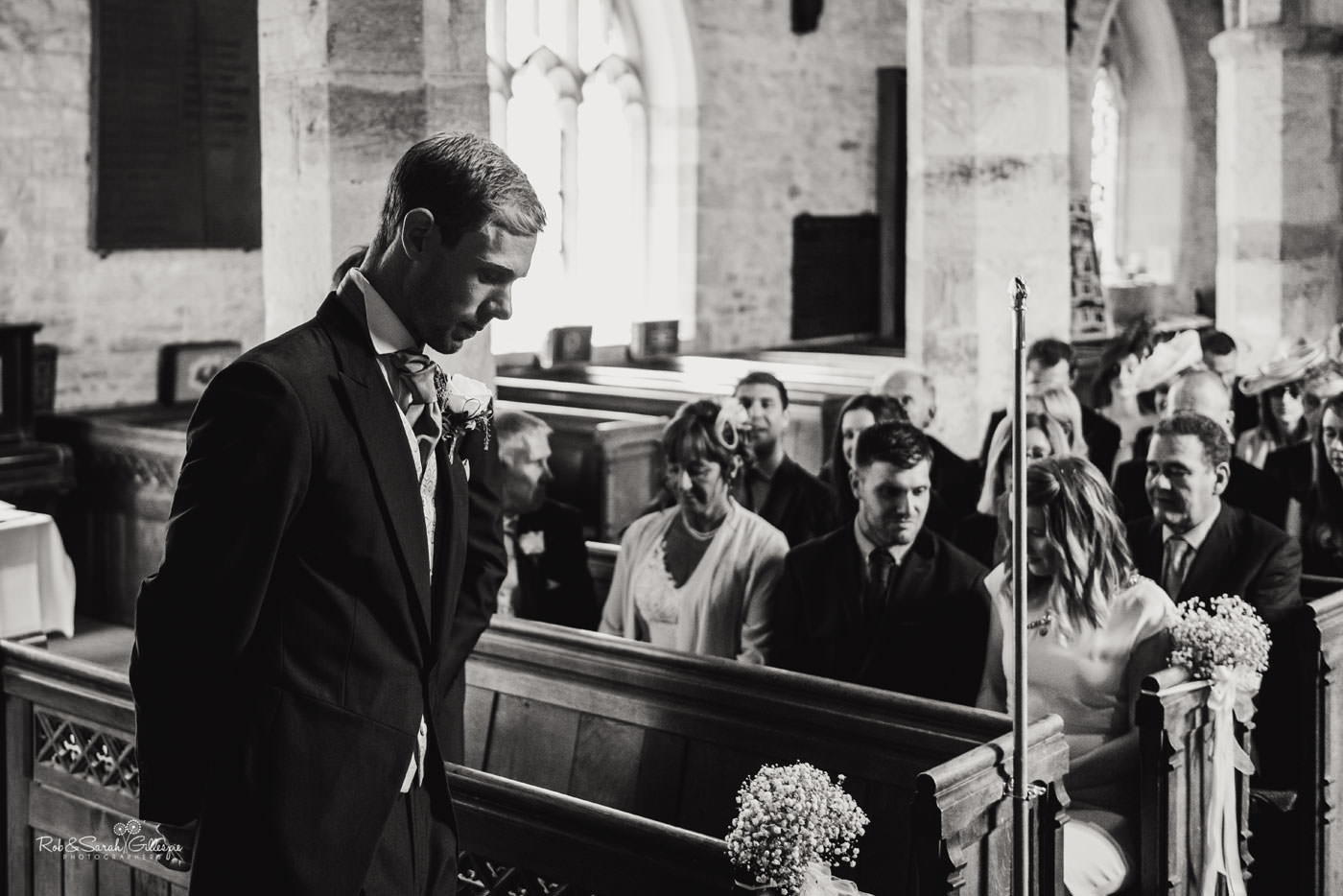 Groom waits nervously for bride at St Peter's Church Diddlebury wedding
