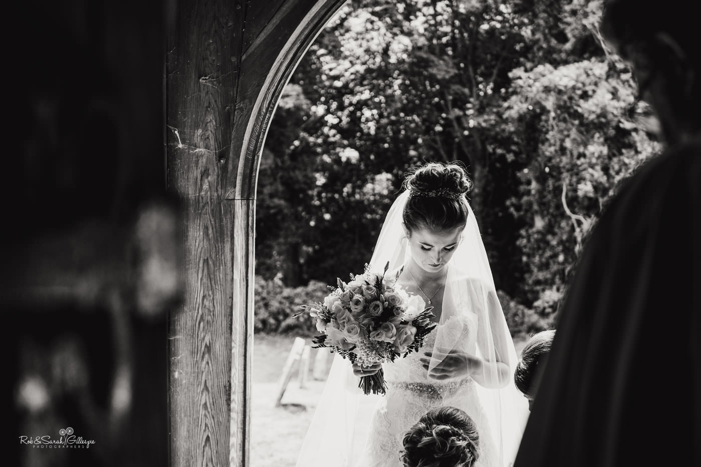 Bride in church doorway at St Peter's Diddlebury