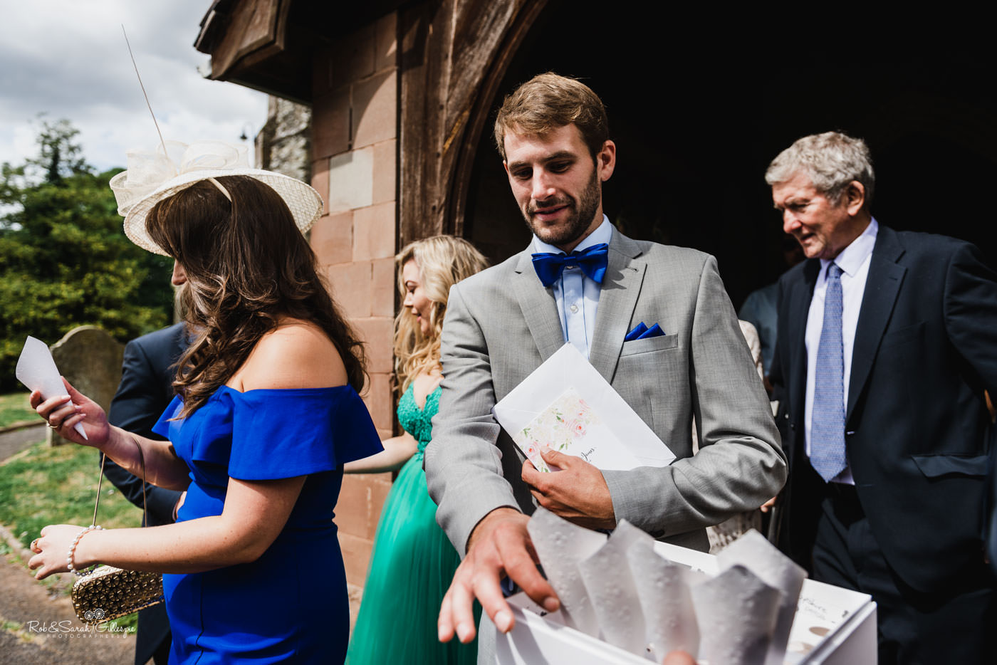 Wedding guests collect confetti
