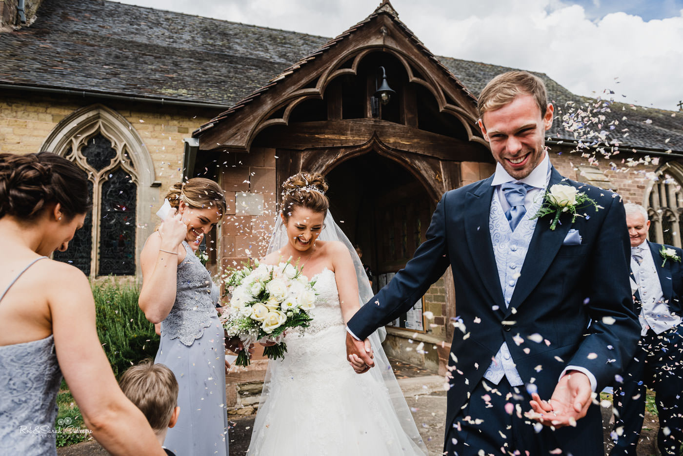 Confetti throw at wedding at St Peter's Church Diddlebury