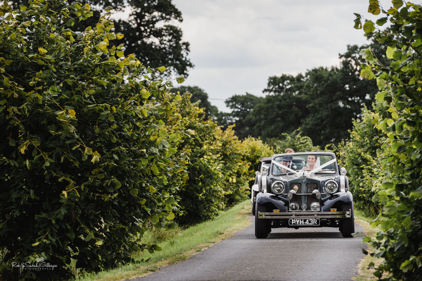 Wedding cars arrive at Delbury Hall in Shropshire