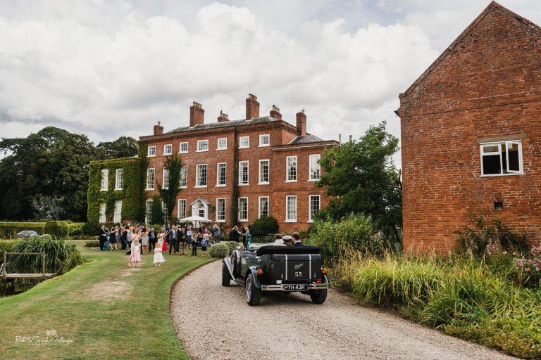 Wedding car arrives at Delbury Hall