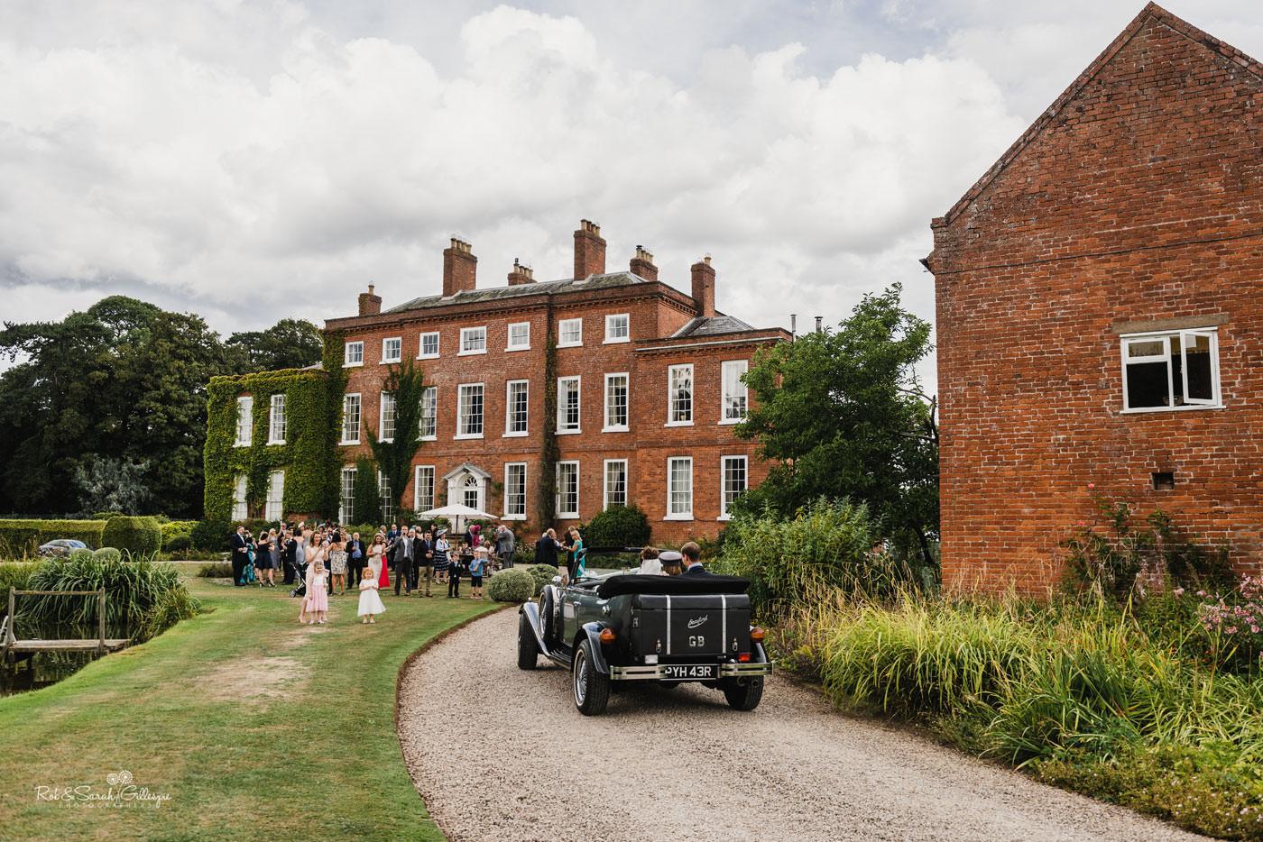 Wedding car arrives at Shropshire wedding venue Delbury Hall