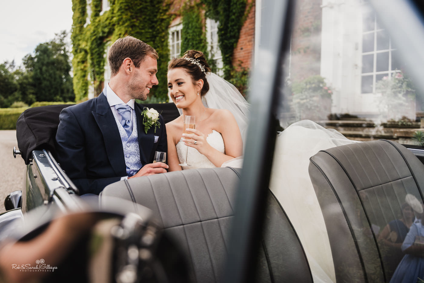 Bride and groom in weding cat at Delbury Hall