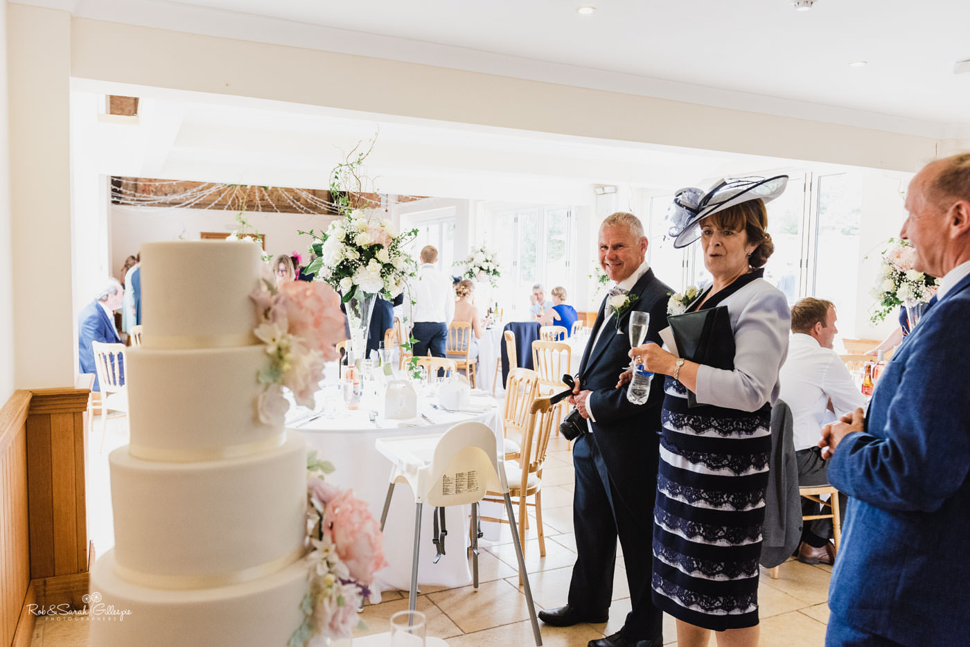 Wedding guests admire cake at Delbury Hall