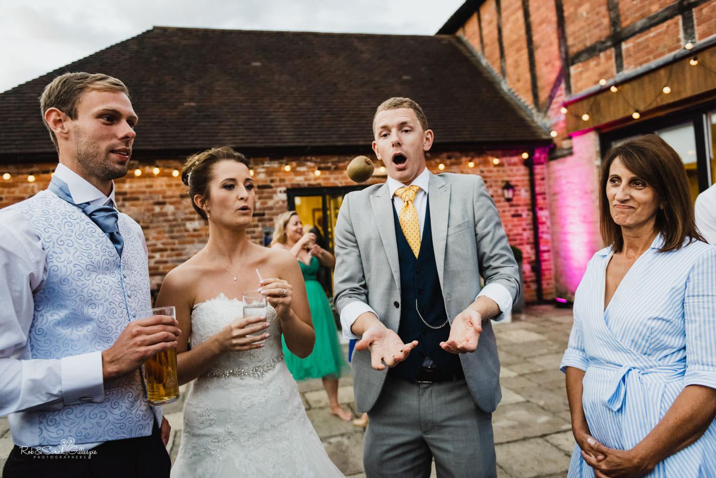Magician entertains wedding guests at Delbury Hall