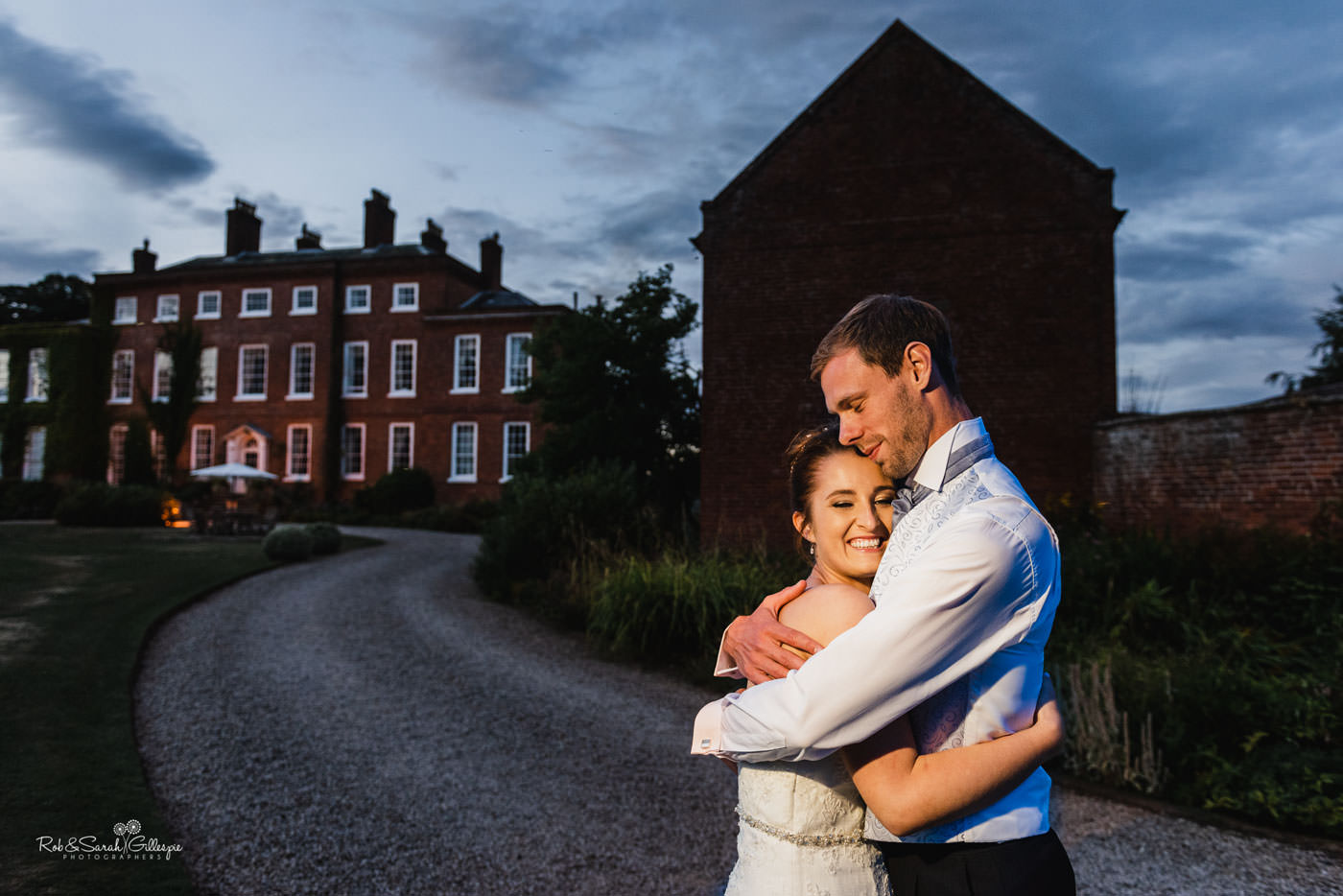 Bride and groom together at Delbury Hall at night