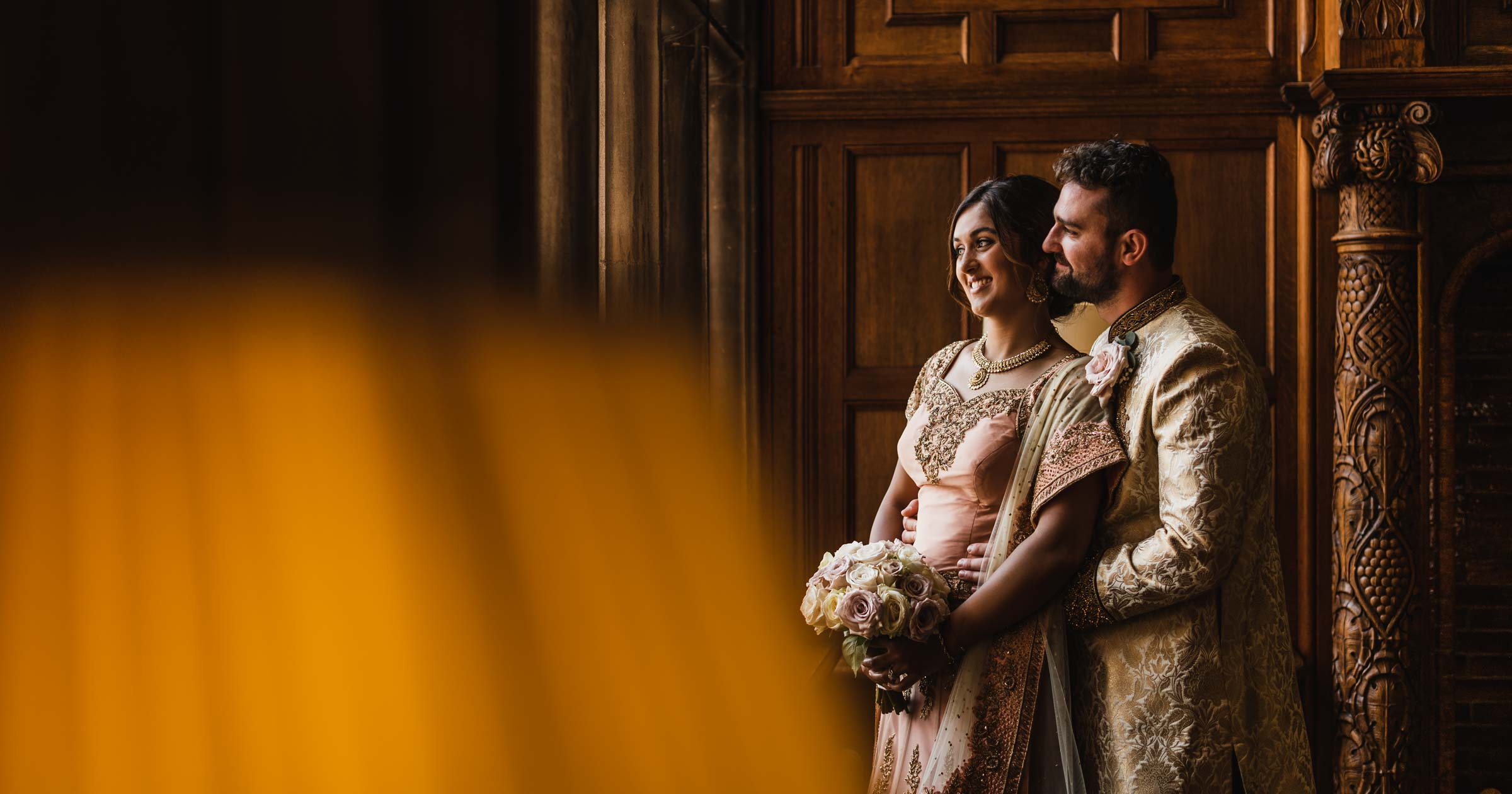 Bride and groom in Indian dress at Pendrell Hall