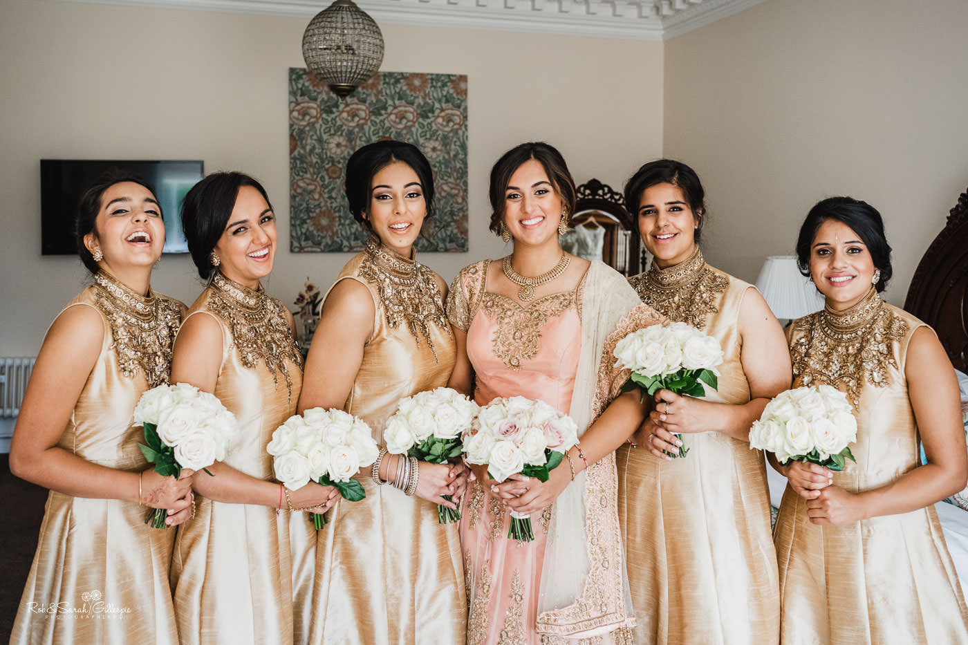 Bride and bridesmaids prepare for fusion wedding at Pendrell Hall