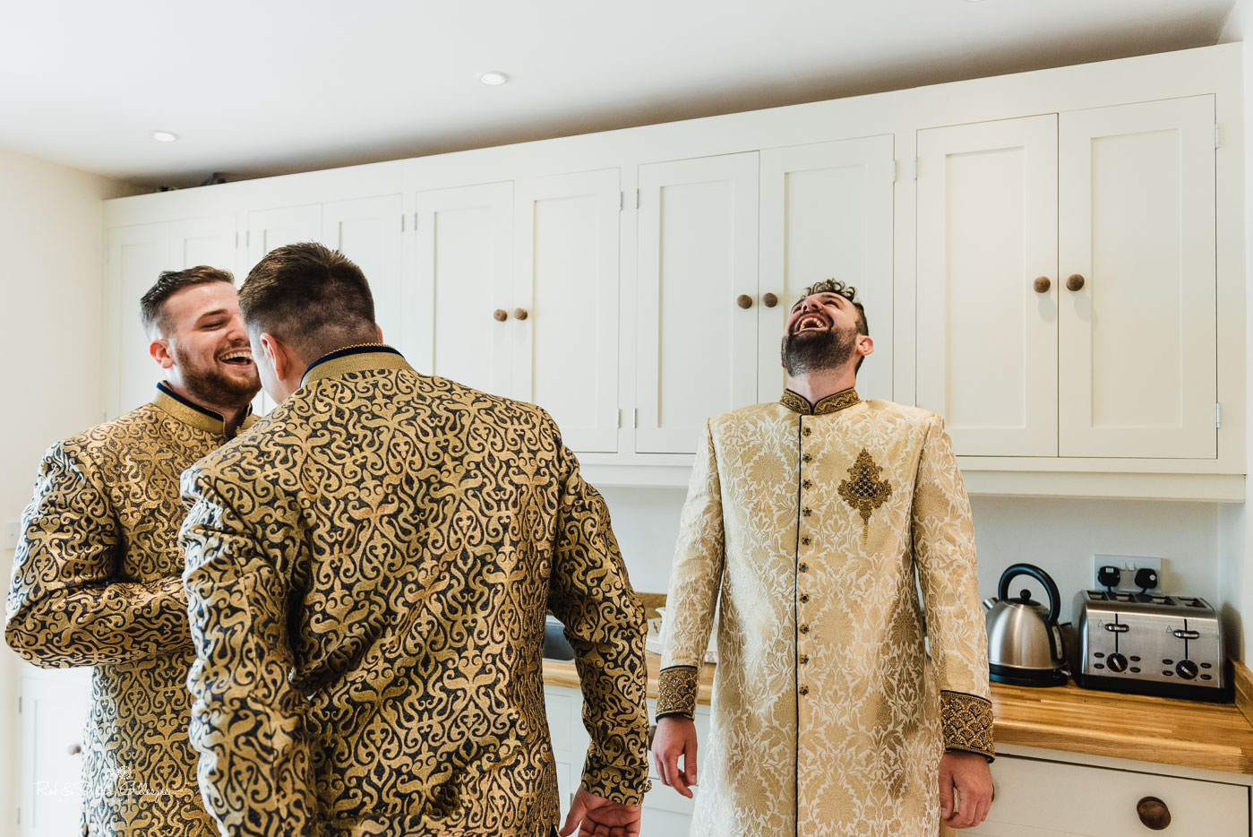 Groom and ushers prepare for fusion wedding at Pendrell Hall in Indian outfits