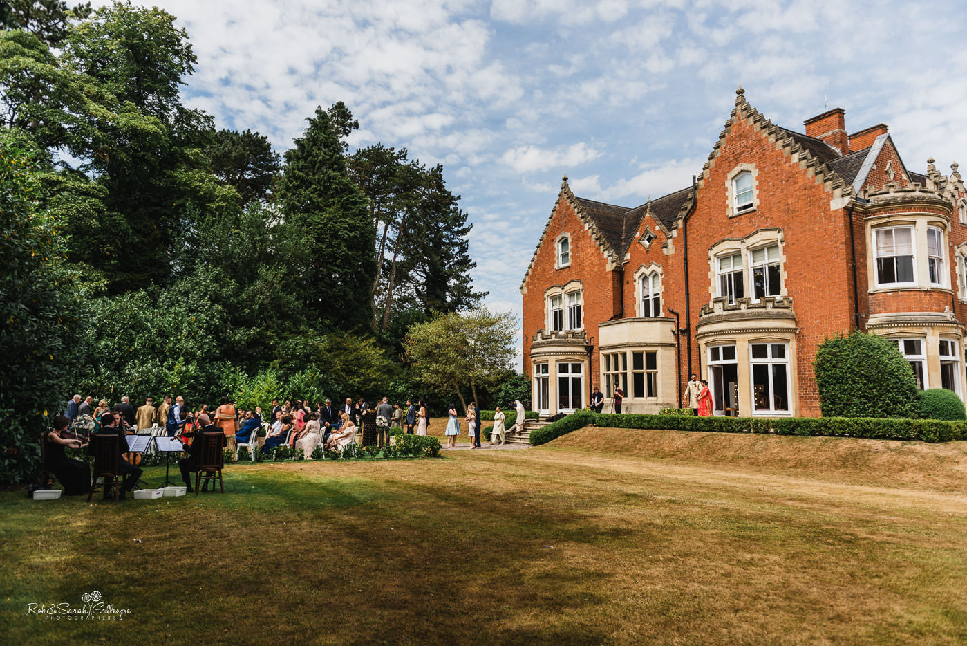 Guests arrive for outdoor fusion wedding at Pendrell Hall