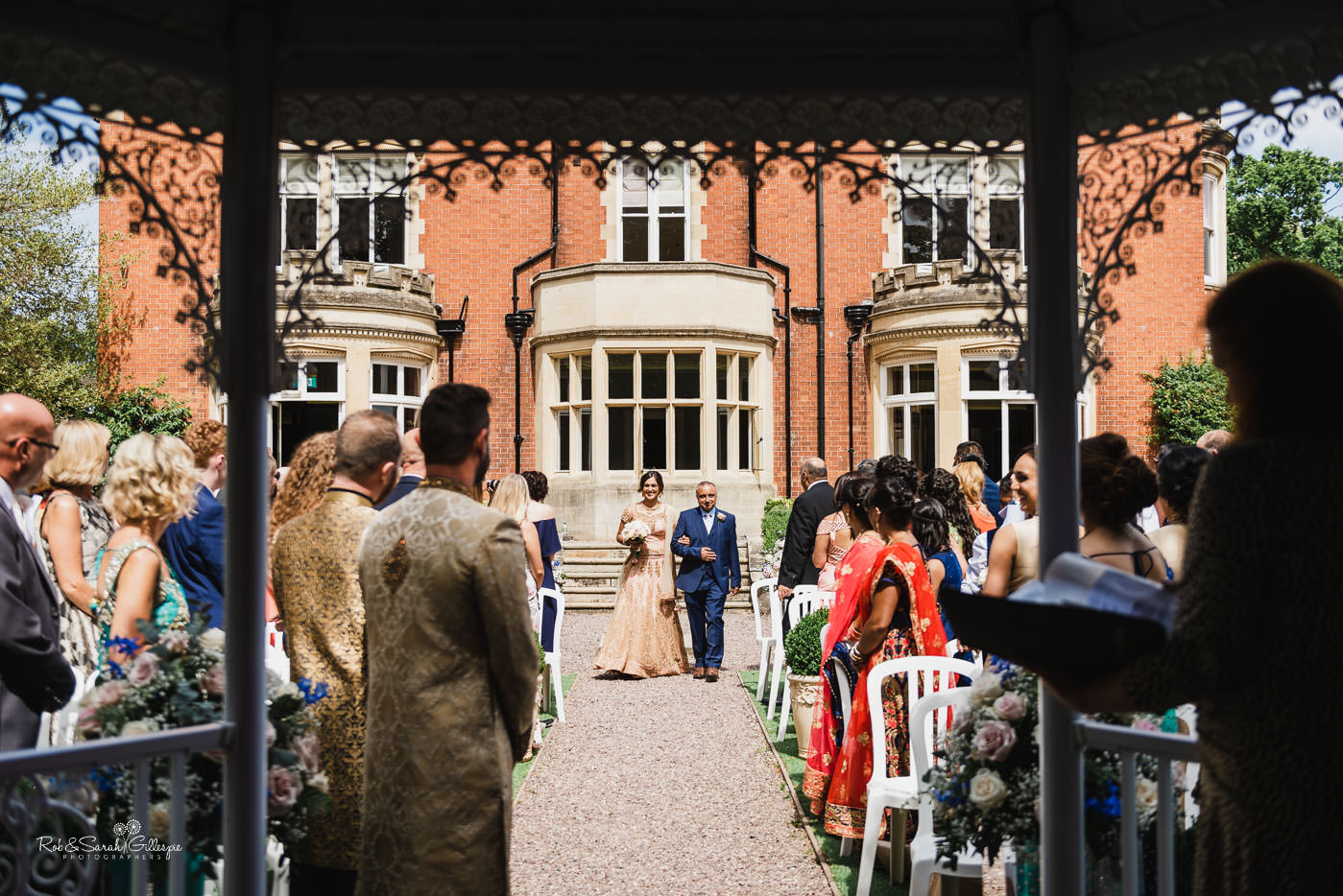 Outdoor fusion wedding ceremony at Pendrell Hall