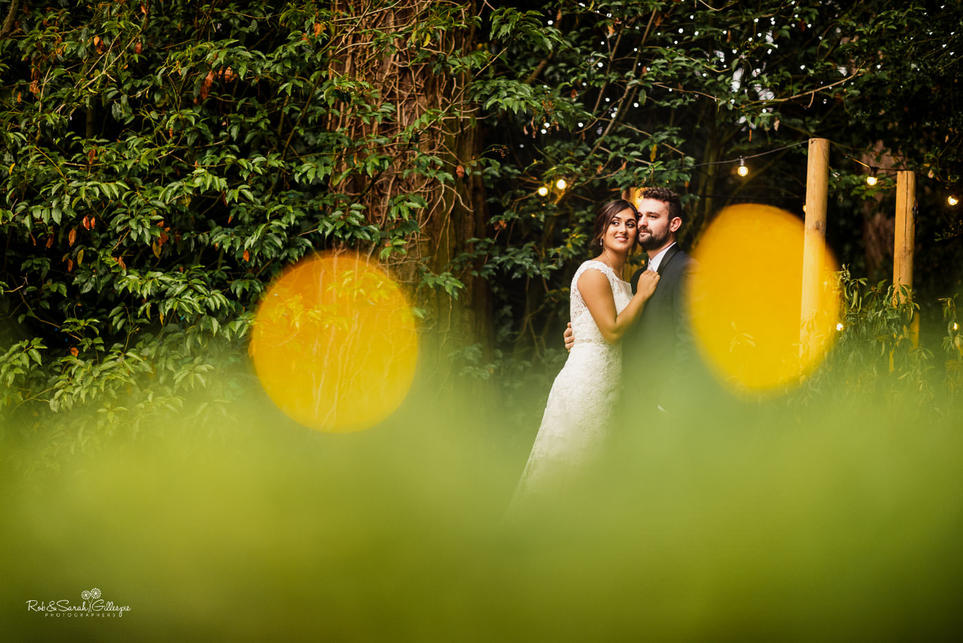 Bride and groom in gardens at Pendrell Hall
