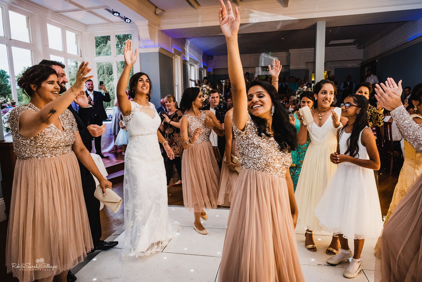 Bride and guests dancing at Pendrell Hall fusion wedding