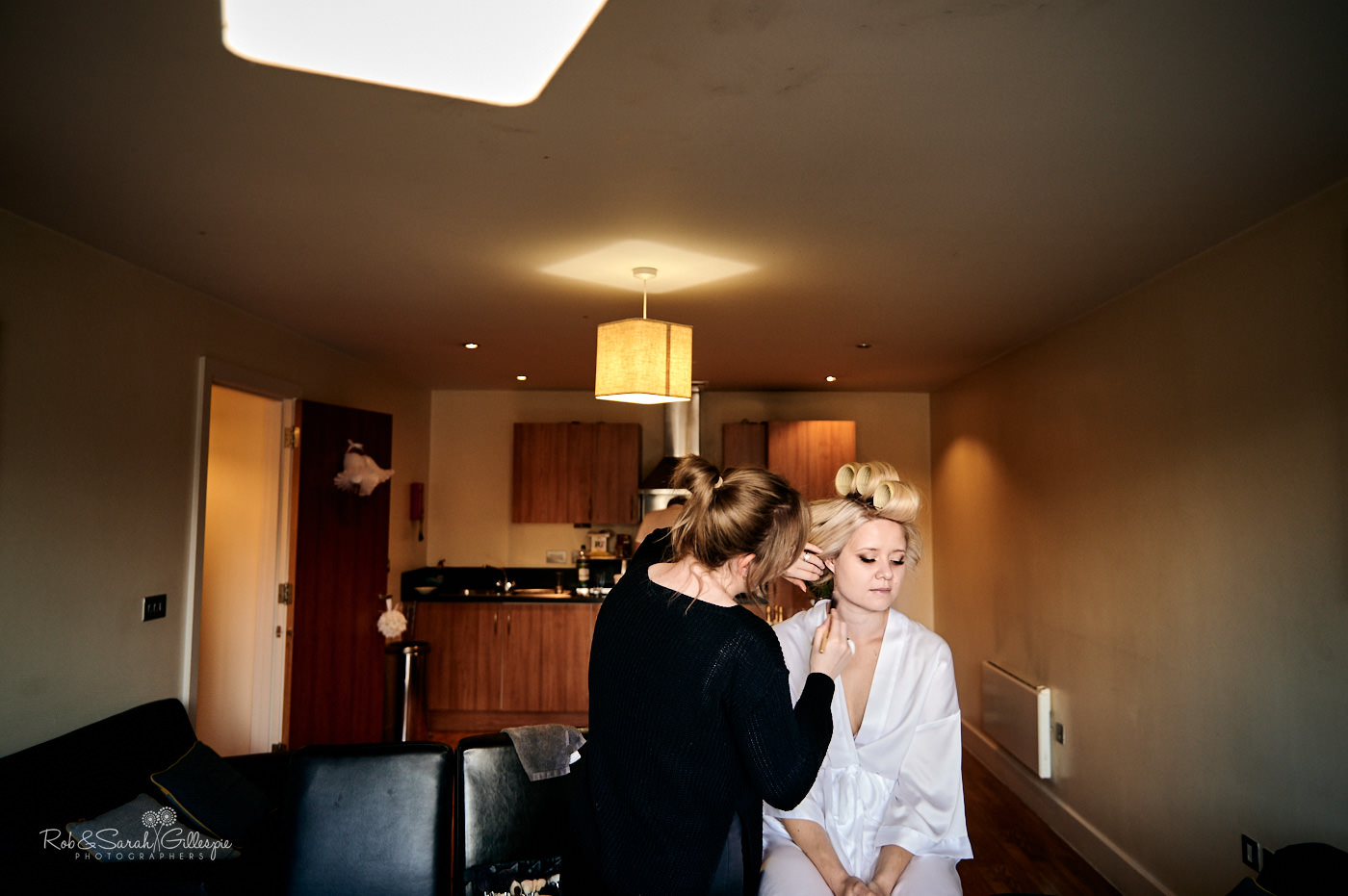Bride has makeup applied before wedding in Staycity Apartments Birmingham