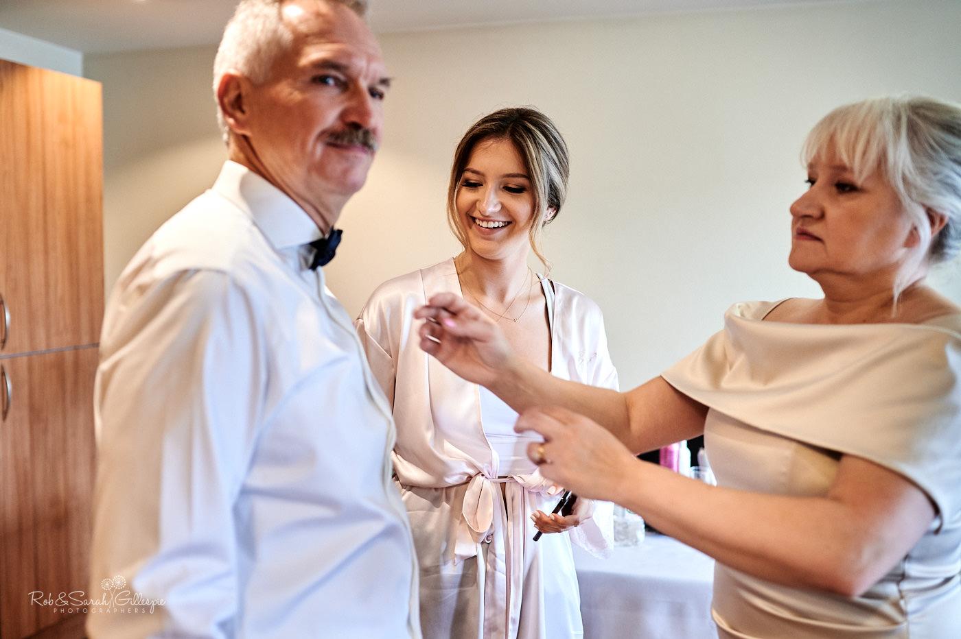 Bridesmaid and brides parents prepare for wedding in Birmingham