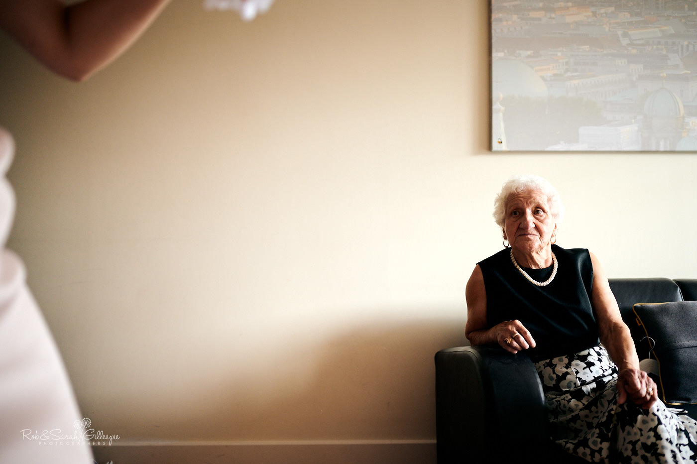 Grandmother looks on as bride prepares for wedding