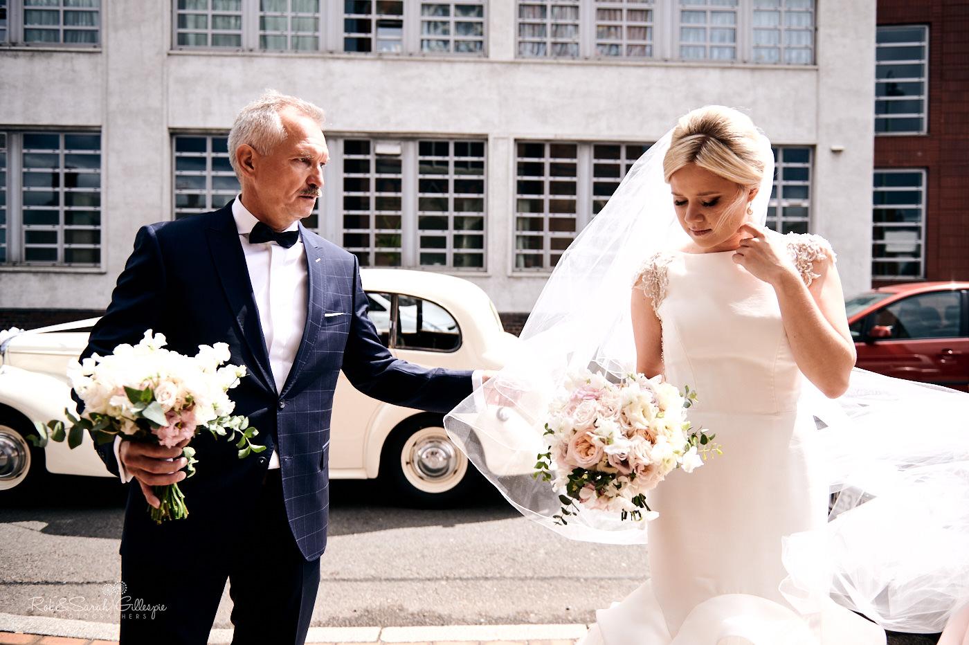 Bride enters St Anne's RC church in Birmingham for wedding