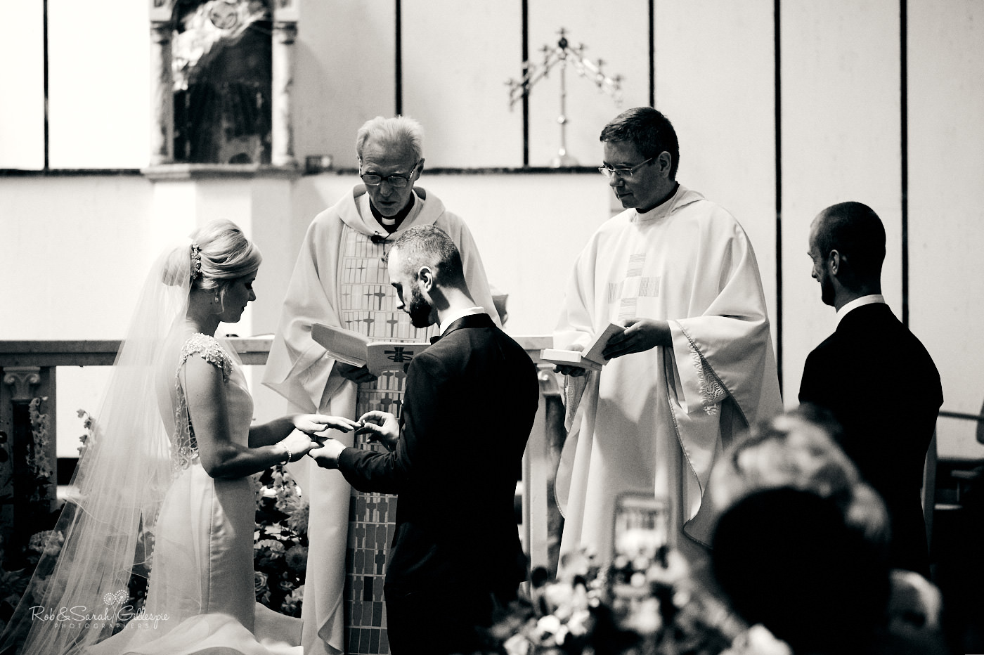 Bride and groom exchange wedding rings at St Anne's Catholic church in Birmingham