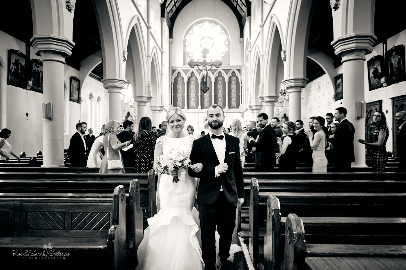 Bride, groom and wedding guests at St Anne's church