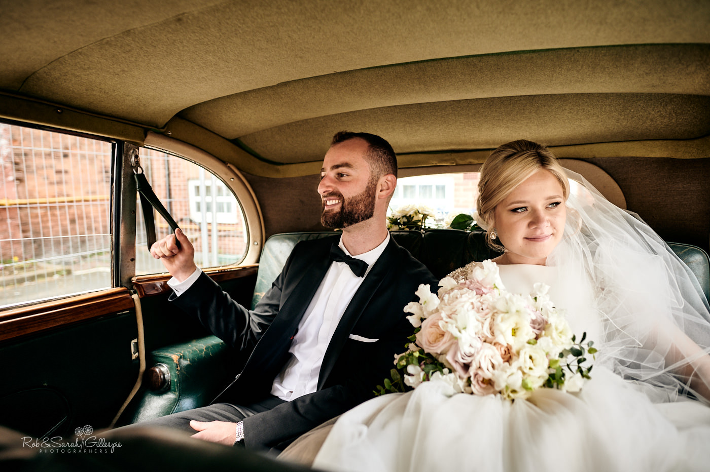 Bride and groom in wedding car