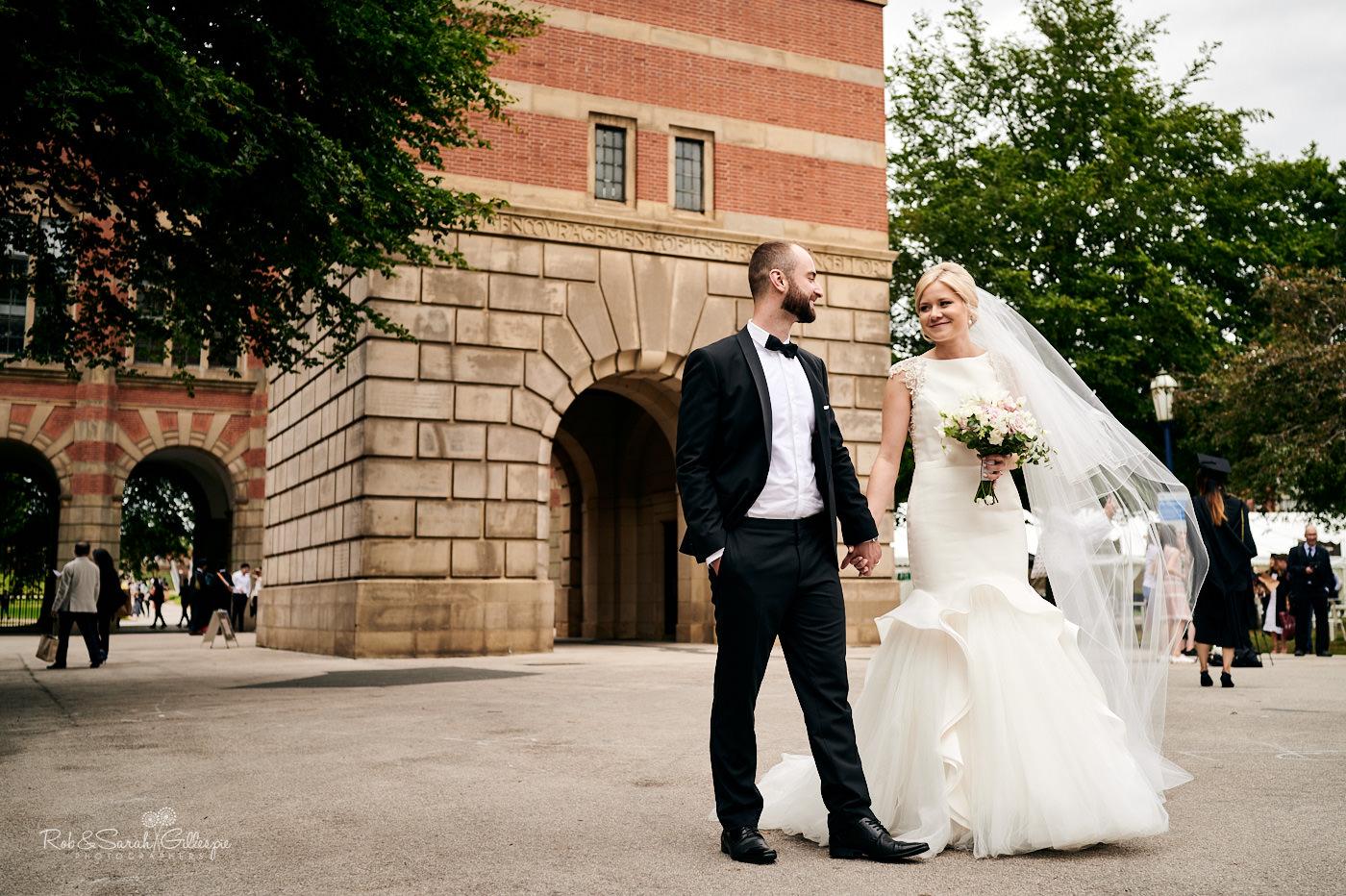 Bride and groom wedding photos inside Birmingham University