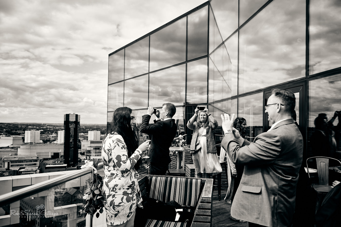 Wedding guests at Veuve Clicquot terrace bar at The Cube in Birmingham