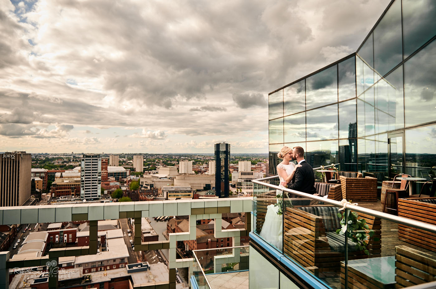 Bride and groom looking over Birmingham from The Cube