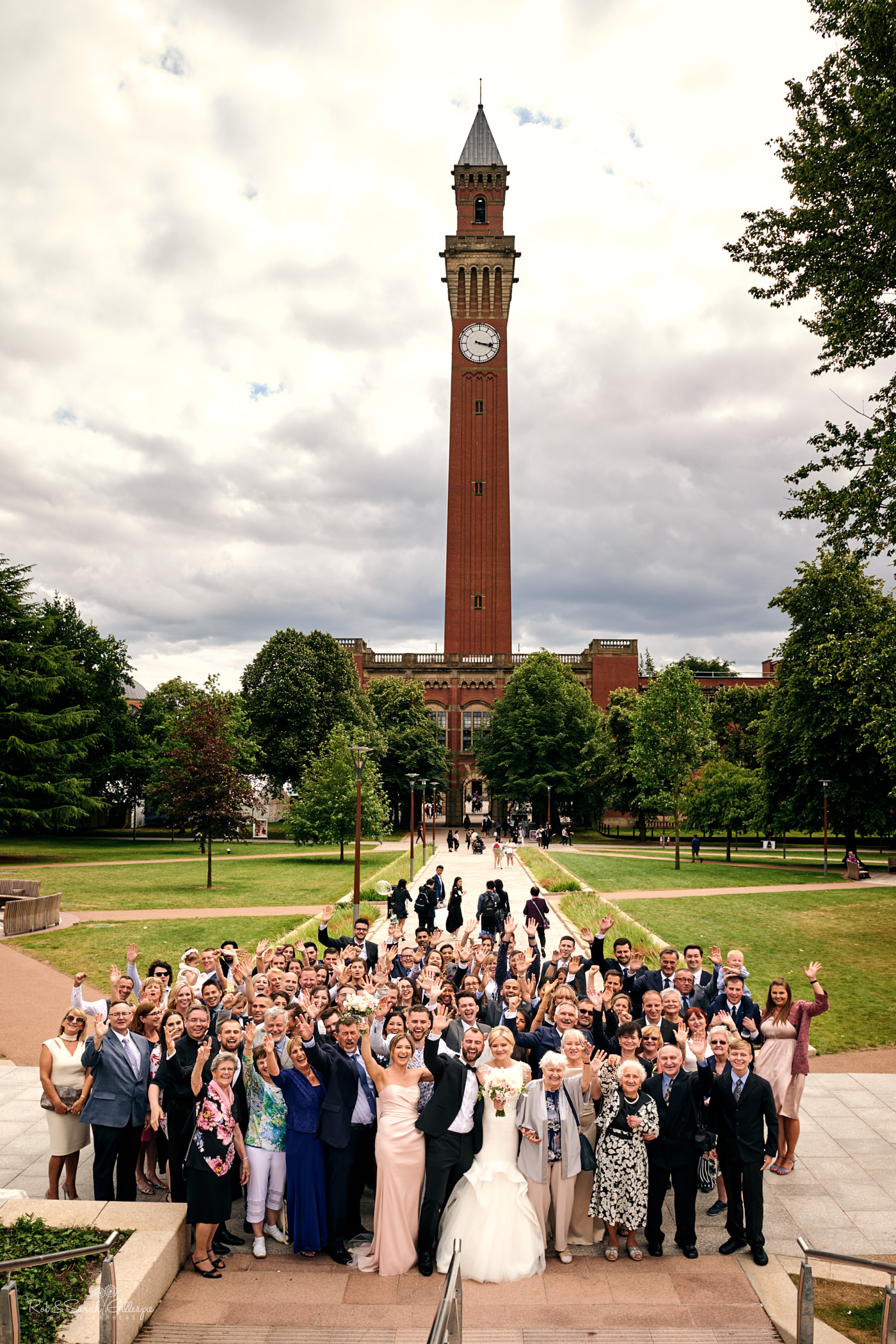 Wedding group photo at Birmingham University featuring Chamberlain clock tower in distance