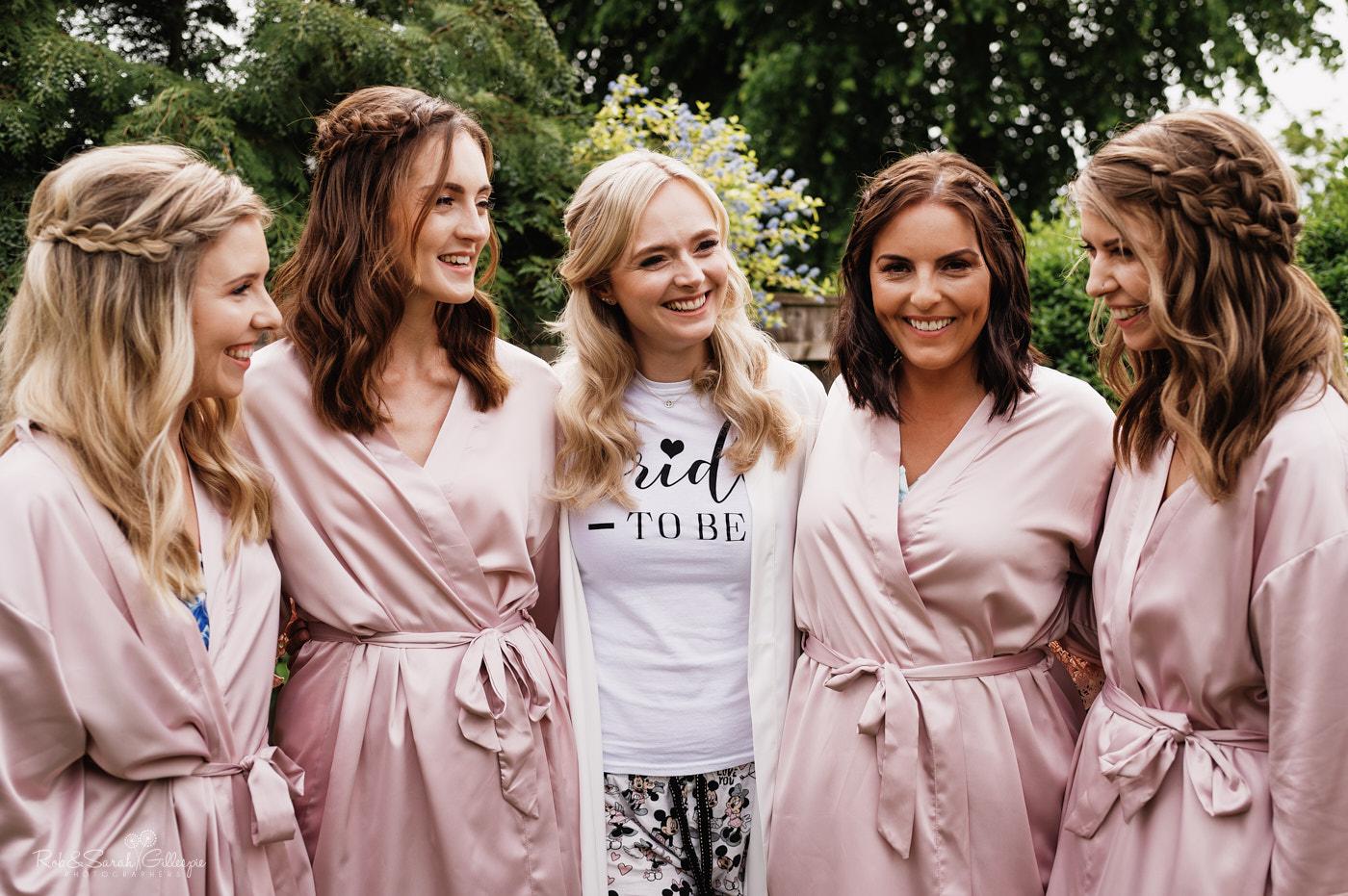 Bride and bridesmaids in garden