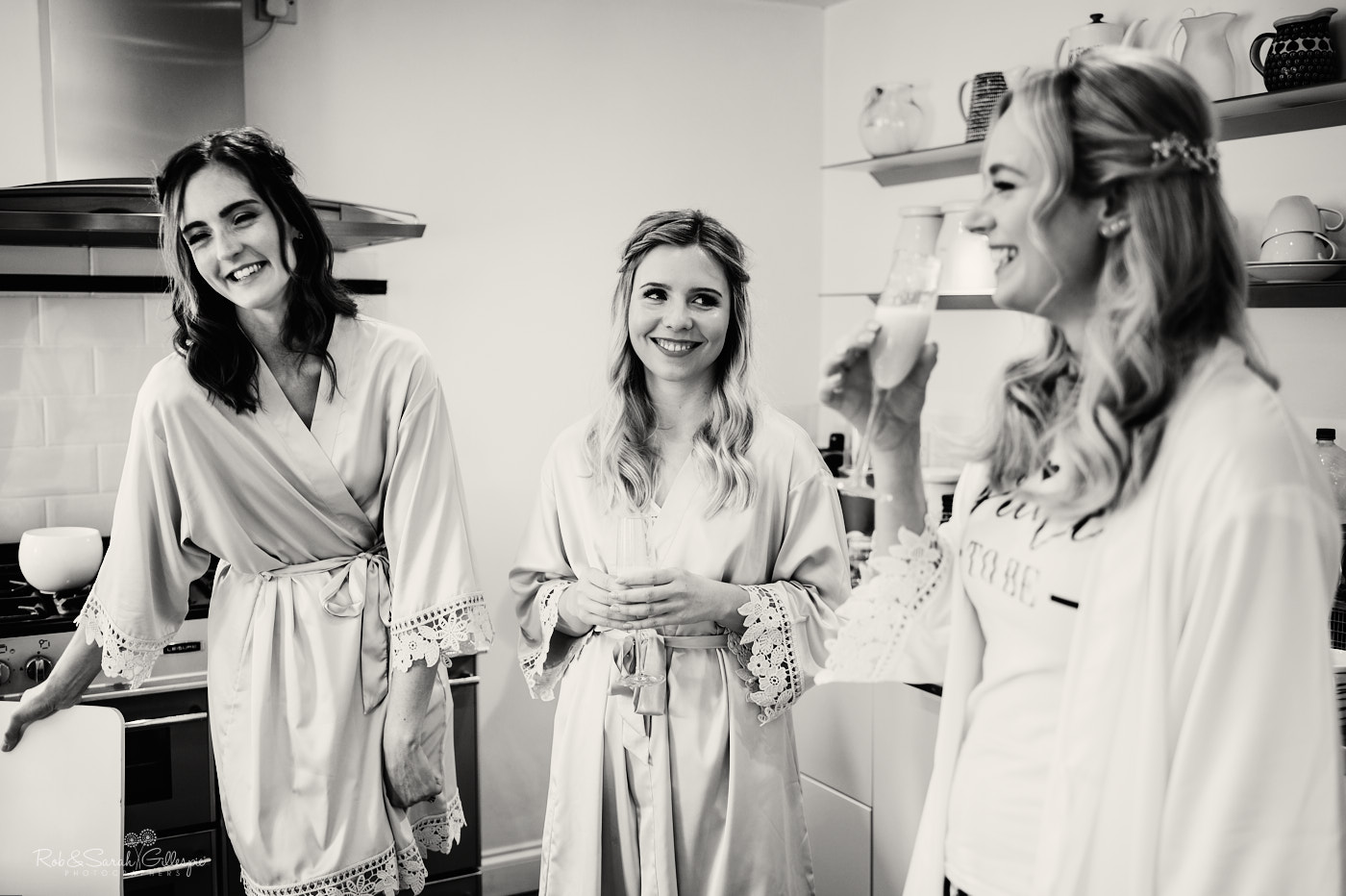 Bride and bridesmaids chat as they prepare for wedding