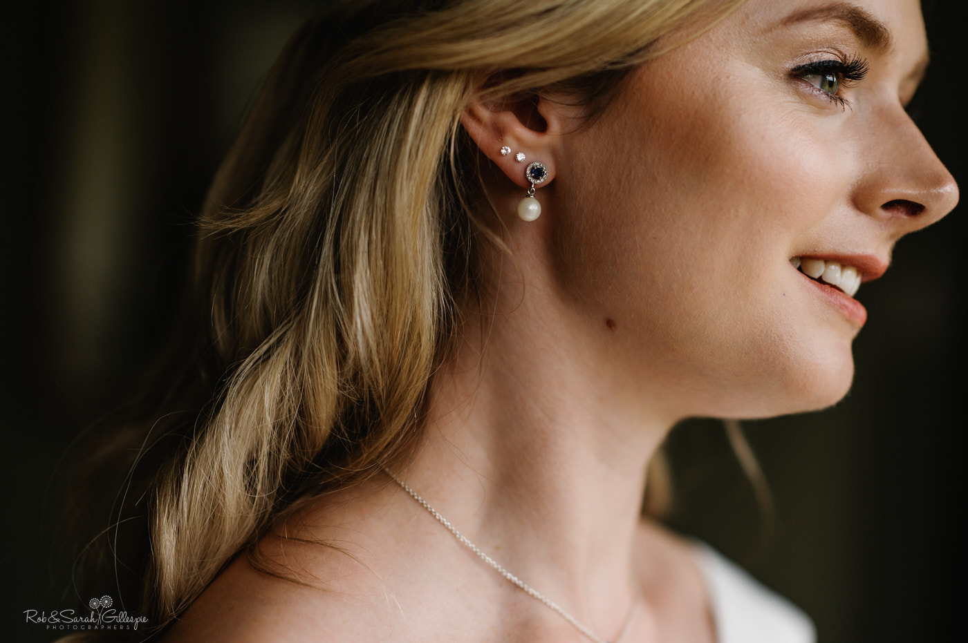 Bride's face with pearl earrings
