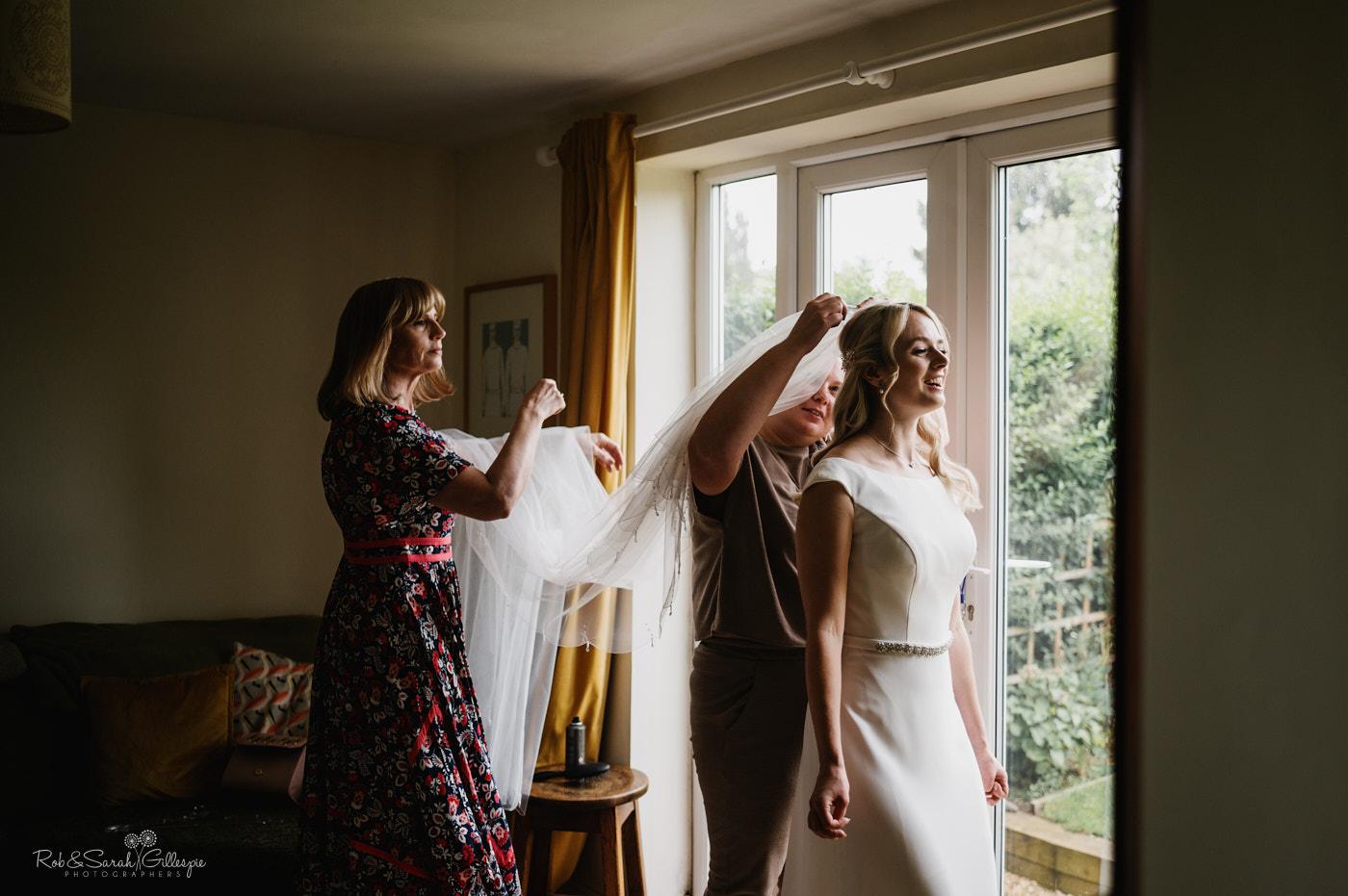 Bride has veil fixed as she prepares for wedding