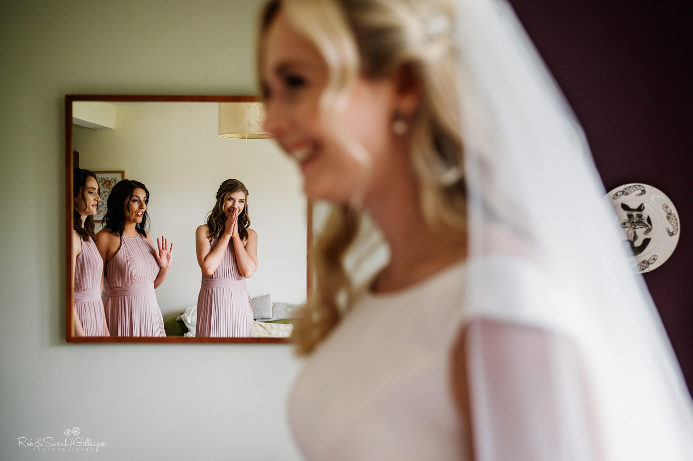 Bridesmaids react to seeing bride in her dress