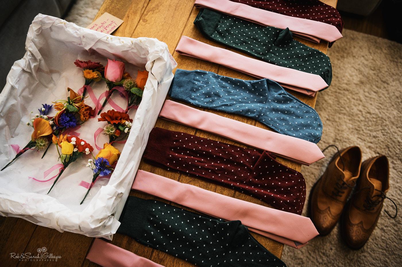 Groomsmens socks, shoes and flowers