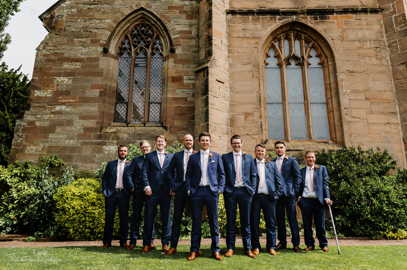 Groom and groomsmen group photo at St Leonards church in Clent, Worcestershire