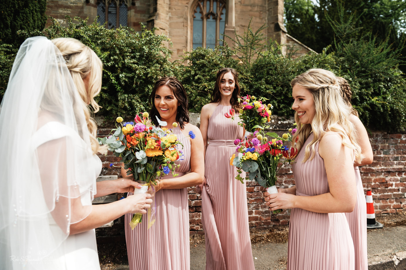 Bride and bridesmaids at St Leonard's church in Clent