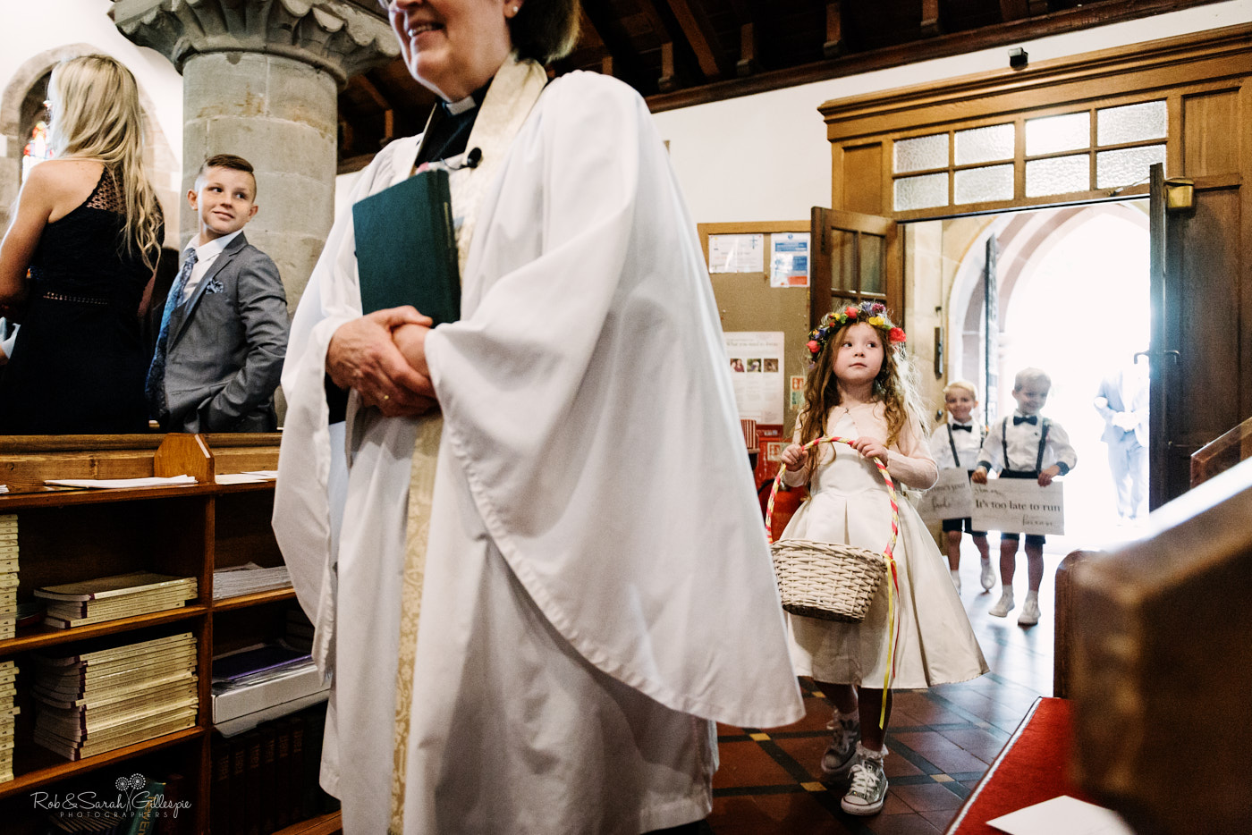 Flowergirl enters wedding ceremony at St Leonard's church in Clent