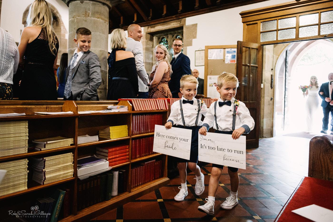 Pageboys enter wedding at St Leonard's church Clent