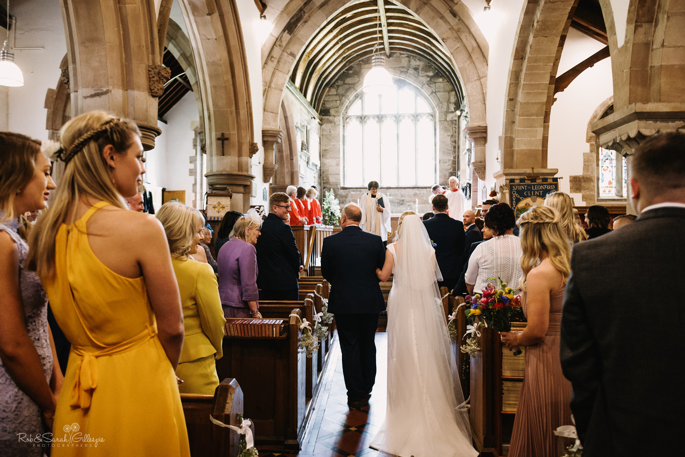 Bride and dad walk up aisle for wedding at St Leonard's church Clent