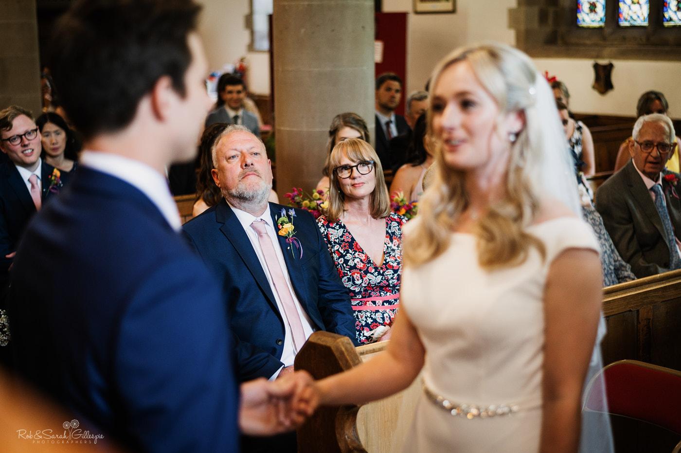 Bride's parents watch wedding ceremony at St Leonard's church Clent